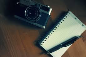 cámara libreta boligrafo